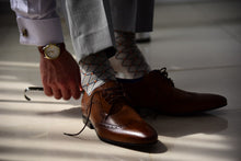 Stylish dress socks for men matching brown derby shoes and gold watch