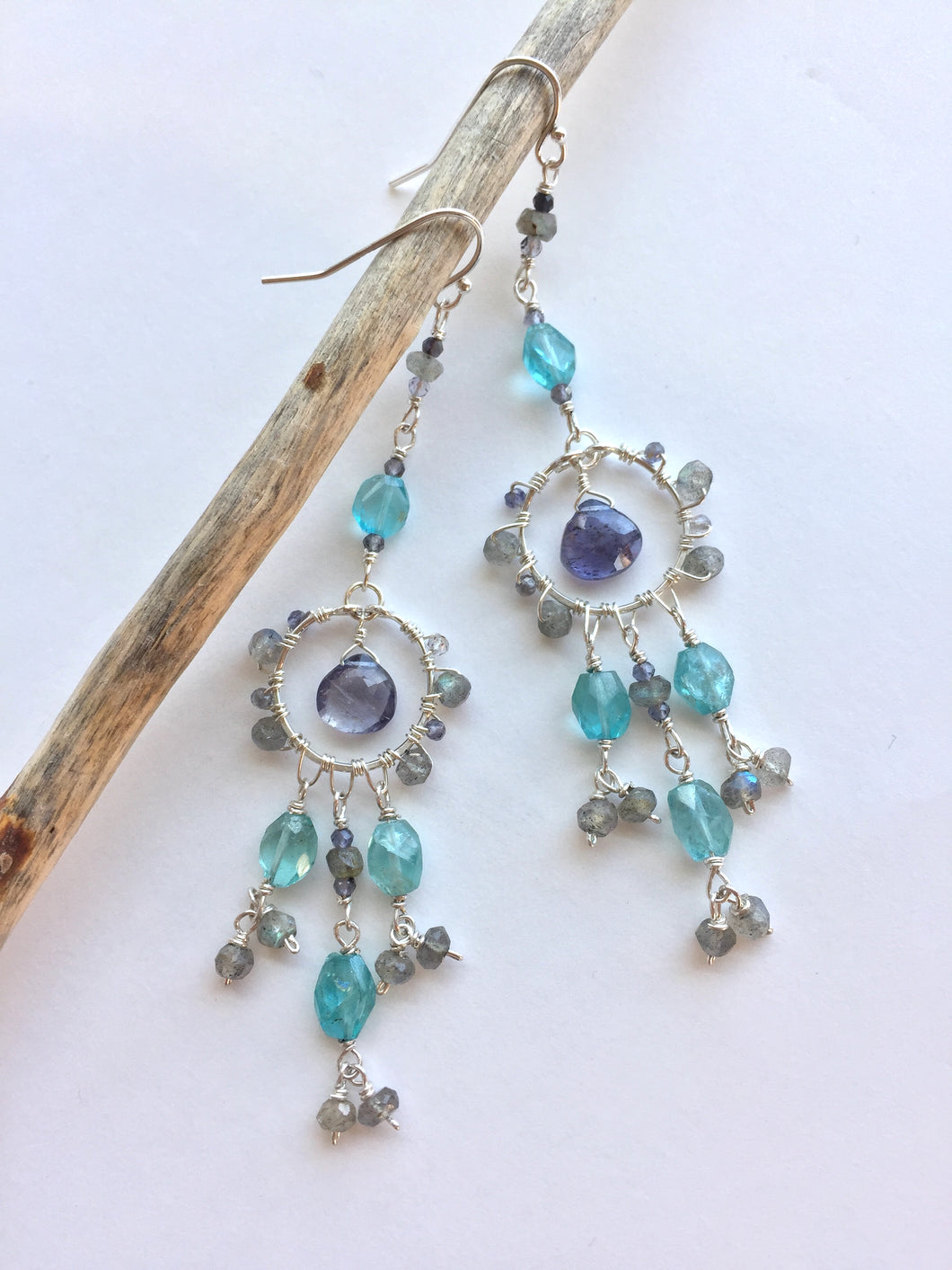 Water Goddess Earrings, hanging on stick