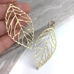 Big Brass Leaf cut out Earrings, in hand