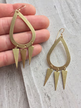 Brass Hoop Trio Triangle Earrings, in hand