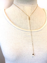 "Chevron & Pearl ""Y"" Necklace on Mannequin"
