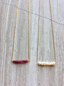 Janie Necklace: garnet, white freshwater pearl, gold chain