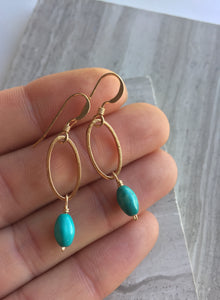 Open Oval Earring — Turquoise, in hand
