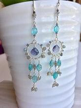 Water Goddess Earrings, hanging on vase