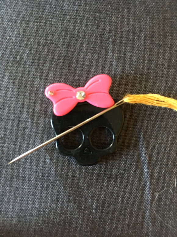 Bright Pink Bow Skull Needle Minder