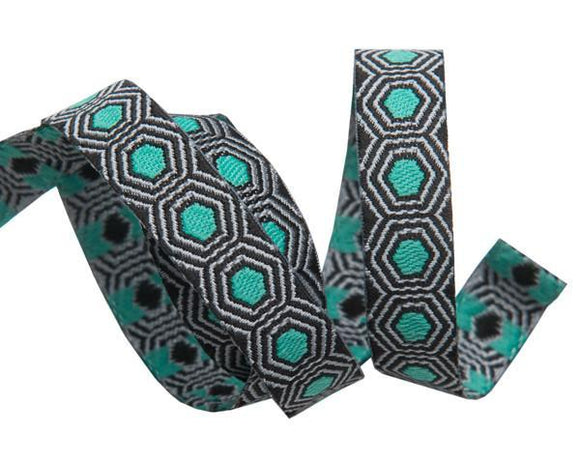 3/8in Jacquard Ribbon, Mint Tortoise Dots on Black from Slow and Steady by Tula Pink for Renaissance Ribbons