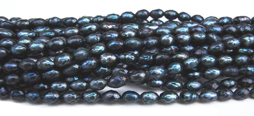 "Midnight Blue Faceted Oval Rice Pearls 16"" Strand"