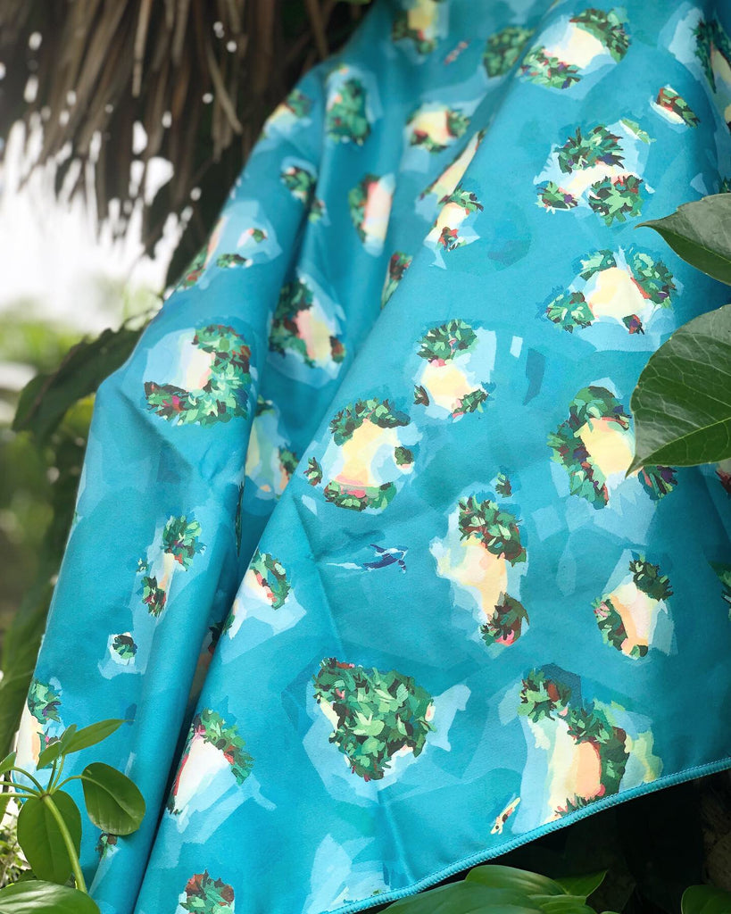 ISLANDS Surfer towel hanging on tree