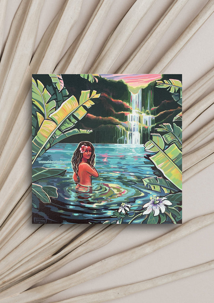 Painting Wailua Waterfall by Christie Shinn, local Hawaii artist.  Painting laying on a white palm frond