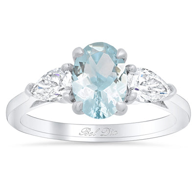 Oval Cut Aquamarine Three Stone Ring with Pear Diamonds