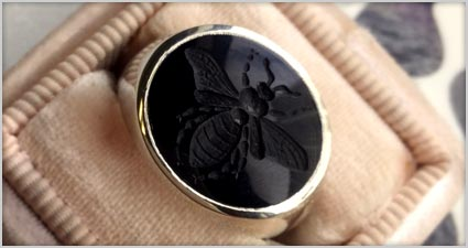 Custom engraved onyx bee gold signet ring from deBebians