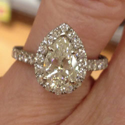 Custom pear shaped diamond engagement ring