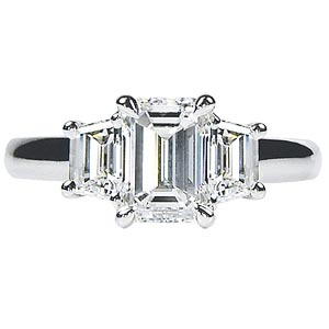 Three stone diamond engagement ring emerald cut diamond trapezoids