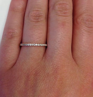 Rose gold thin diamond band modeled on the left hand by one of our employees