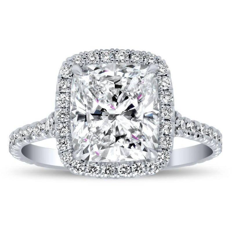 Round Halo Engagement Ring with Channel Set Baguettes