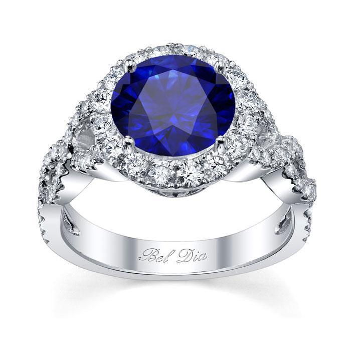 Blue Sapphire Halo with Twisted Shank Sapphire Engagement Rings deBebians