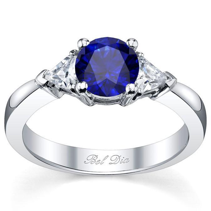 Blue Sapphire Three Stone Ring with Trillions Sapphire Engagement Rings deBebians
