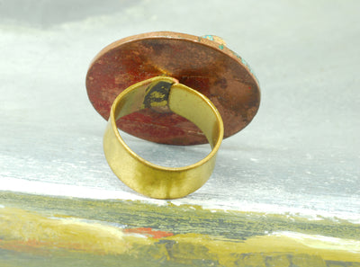 red oxidized coin ring