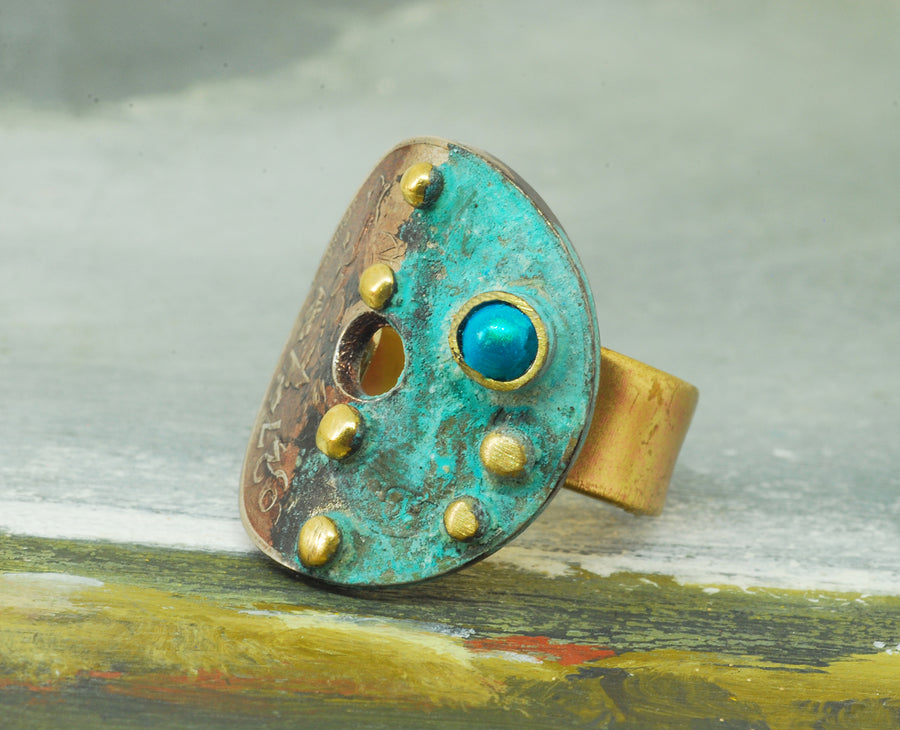 light blue oxidized coin ring