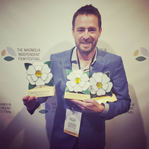 Director Sean Bloomfield with three awards from the Magnolia Independent Film Festival