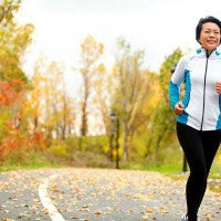 asian_woman_jogging_fall_autumn_leaves_outside_happy_pic