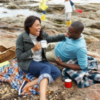 family_couple_kids_beach_rocks_picnic_wet_cool_fun_windy_lunch_blankets_basket_pic