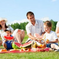 family_man_women_children_picnic_outside_spring_watermelon_lunch_food_healthy_fruit_yum_pic