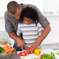 father_son_cook_vegetables_cut_knife_teach_example_pic