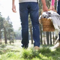 picnic_couple_happy_basket_blanket_spring_grass_field_trees_country_walk_pic