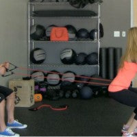 tim_mccomsey_marzia_prince_wall_sit_partner_workout_pic