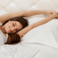 waking up_morning_stretch_bed_happy_woman_pic