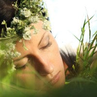 warm_woman_sleeping_nature_grass_outside_pic