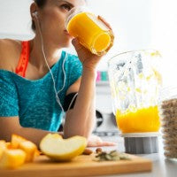 woman_exercise_pumpkin_smoothie_earbuds_workout_fuel_food_blender_pic