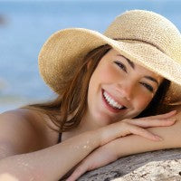 woman_young_smooth_skin_ocean_beach_hat_sun_pic