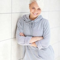 woman_young_white_hair_wall_lean_crossed_arms_smile_happy_secure_pic