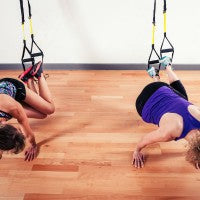 women_exercise_TRX_straps_fitness_health_balance_workout_pic
