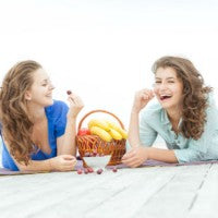 women_young_relax_blanket_shore_dock_sunny_basket_fruit_grapes_eat_pic