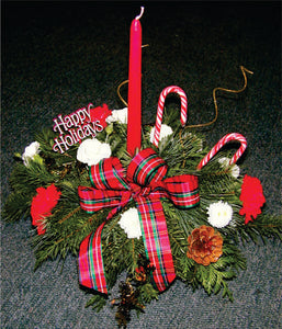 XC 1152 Christmas centrepiece with flowers, greens and candle.