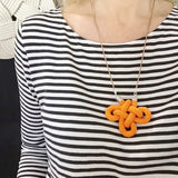 Charmed knot necklace in mustard