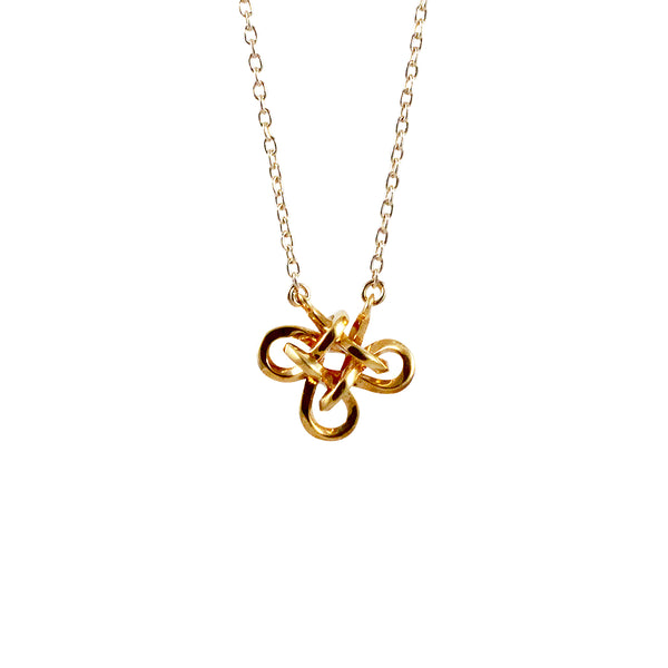 Charmed knot necklace in gold and silver