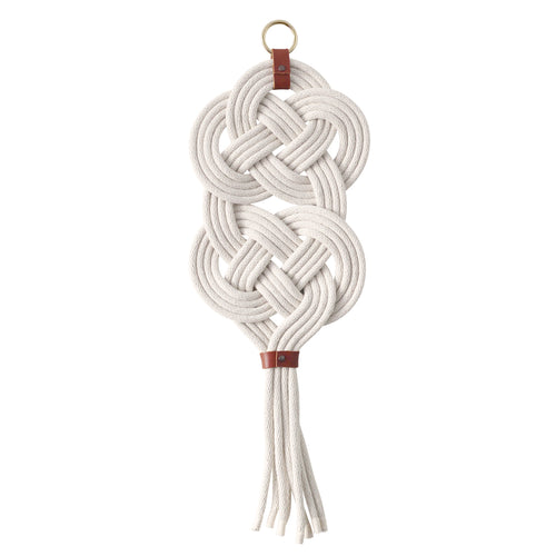 Lover's knot wall hanging. Macrame knot featuring woven rope.