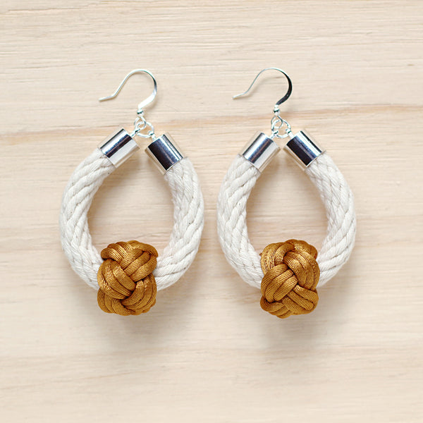 Safari Earrings in natural with gold knot