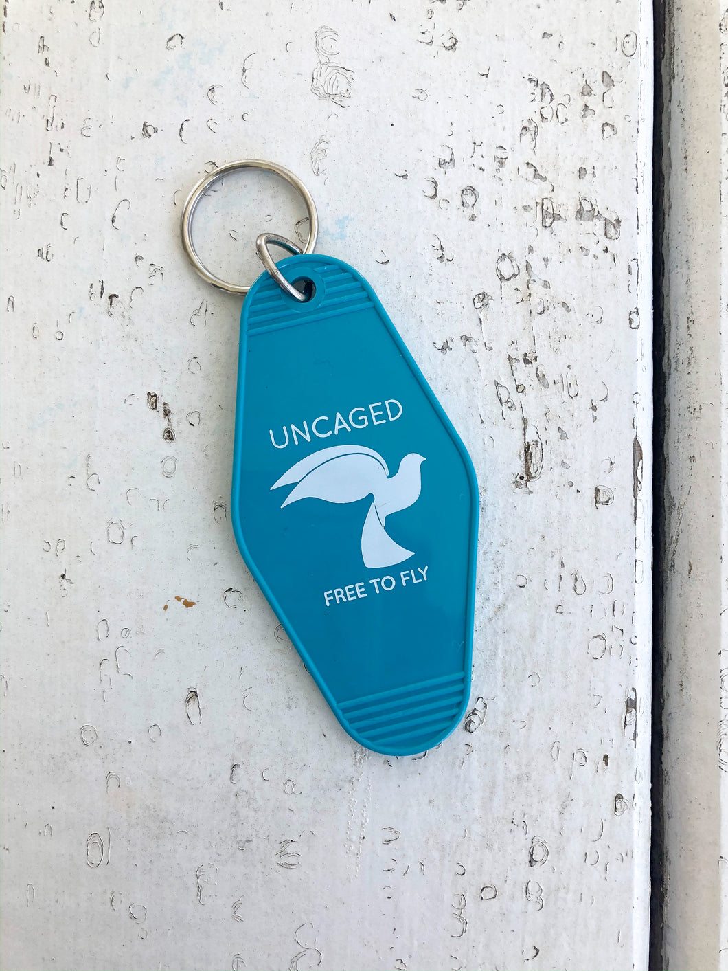 Uncaged Motel Keychain