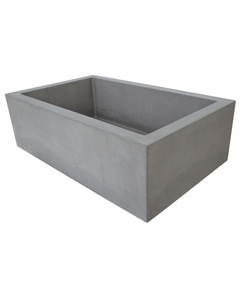 Right side view of Hyde Concrete's Farmhouse 1 style bathroom trough sink. Pictured in OPC Portland Cement color.