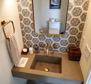 A modern bathroom with Hyde Concrete's Crab Pot style sink. Color shown is Concrete gray.