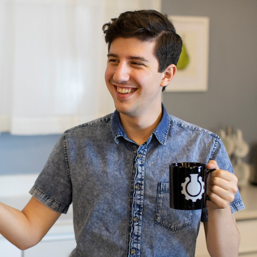 Joseph enjoys a cup of coffee from Pixel's CGP Grey mug.