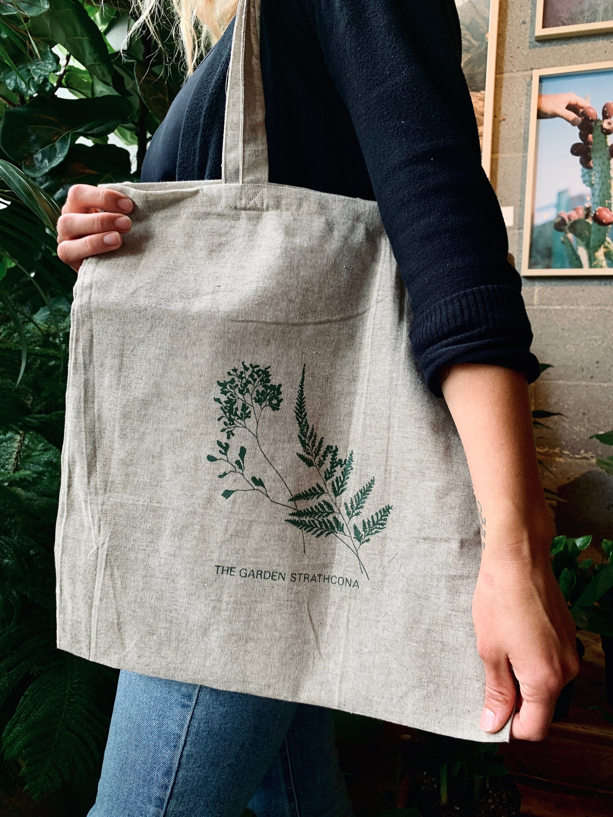The Garden Strathcona branded grey tote bag made from 100% organic recycled materials