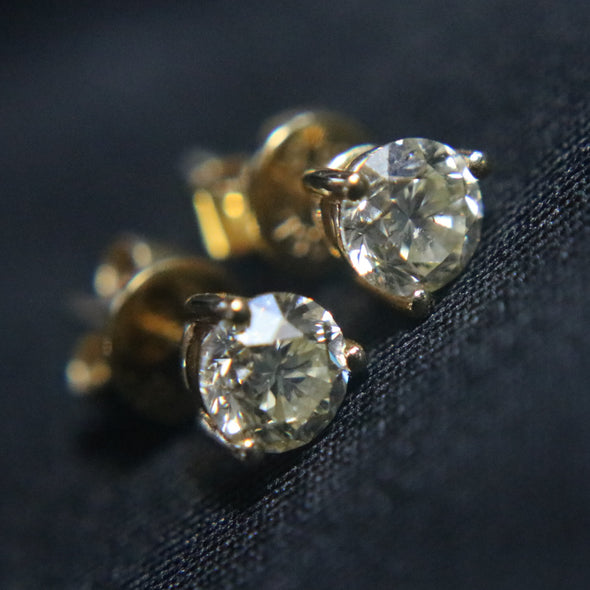 0.934 carat solitaire diamond earrings set in 18k yellow gold