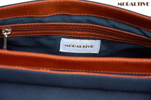 Backpack details of pockets & zip - navy blue canvas & tan leather