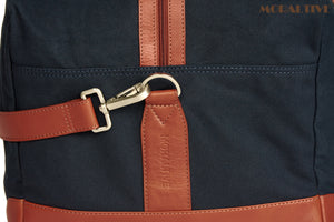 Duffle Bag Closeup - Navy Blue Canvas & Tan Leather